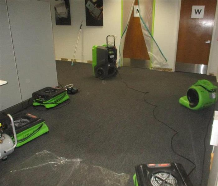 Drying equipment placed to dry carpet.